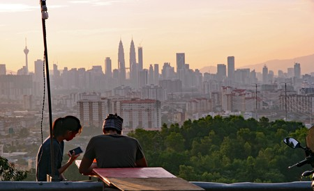 Young couple enjoying the view of Kuala Lumpur's skyline