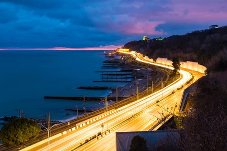 View of the sea and Kurortny Prospekt with light trails, Sochi, Russia
