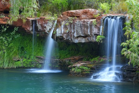 A small waterfall flowing into the Fern Pool in Karijini National Park, Western Australia