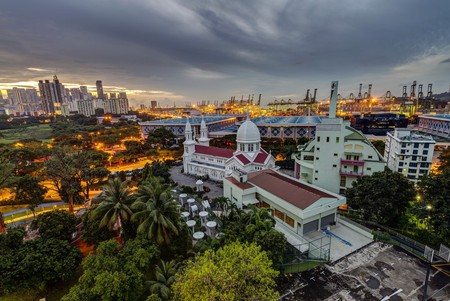 An aerial view of the Romano-Byzantine-inspired Church of St Teresa, against the backdrop of contemporary Singapore