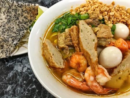 Enjoy some Vietnamese mì quảng noodles.