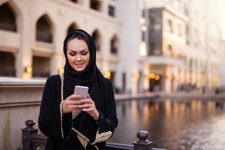 Muslim woman using mobile phone