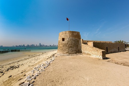 Bu Maher Fort in Arad with the beach and view of Manama city