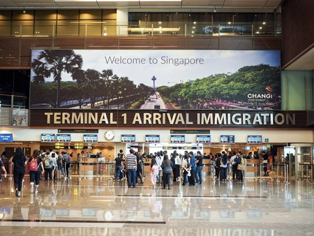 Travellers waiting in queue at arrival immigration of Changi International Airport in Singapore