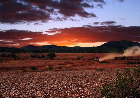 Sunset road trip through the Australian outback