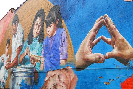 A colorful public mural in Chicago's Pilsen neighborhood.