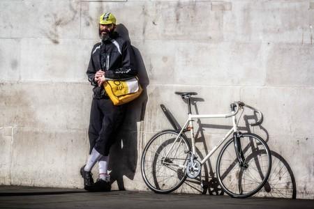 A bike courier takes a break
