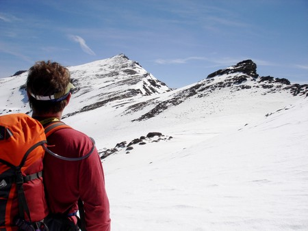 Trekking in a snow covered Sierra Nevada