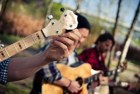 A guitarist tuning his guitar in Mauerpark