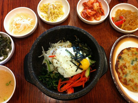 Dolsot (stone pot) bibimbap and assorted vegetable side dishes
