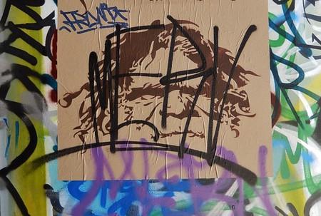 Defaced mural of an Indigenous Australian