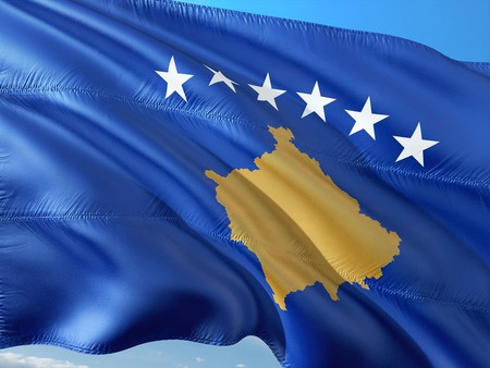 The national flag of Kosovo with the six stars that represent the country's six ethnic groups