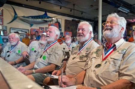 Past winners of the Hemingway look-alike contest examine the 2017 entrants