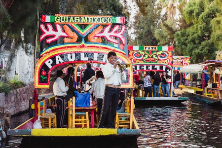 Mariachi bands playing music along the canal