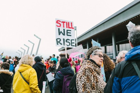 A 'Still We Rise' protest sign at a demonstration