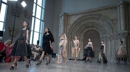 Models present creations from the Fall/Winter 2018/19 Haute Couture collection by Guo Pei