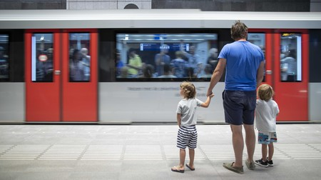 A man and two children wait for the metro, Amsterdam, the Netherlands