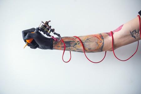 Tattoo artist holding tattoo machine