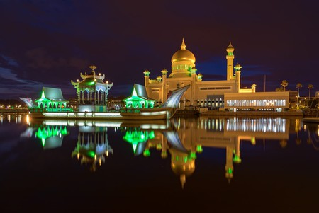 By night, the lights of the Sultan Omar Ali Saiffudien Mosque glisten on the adjacent lagoon