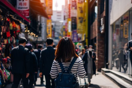 Young woman traveling and shopping in Myeongdong street market at Seoul, South Korea.