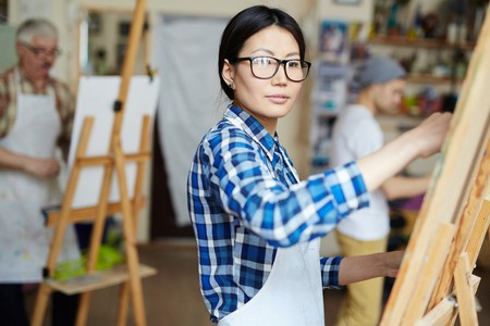 Student painter in the studio