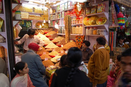 A busy spices and dried fruits shop in Old Delhi