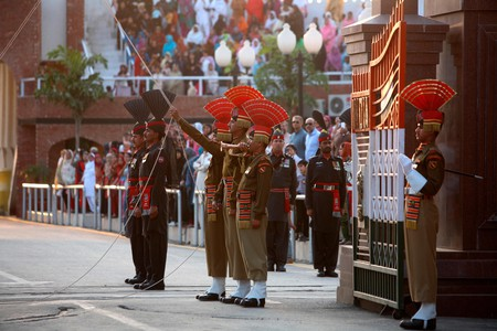 Indian Border Security Force soldiers and their Pakistani counterparts on parade before the start of a changing of guard ceremony  at the Wagah-Attari border between India and Pakistan