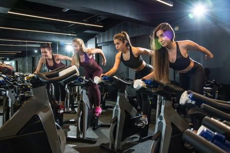 Girls riding exercise bikes