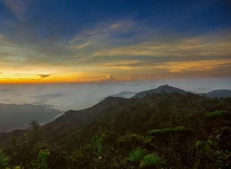 Sunrise view at the peak of Mount Tahan
