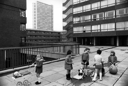 Pepys Estate, Deptford, London: children playing on a raised walkway, 1970