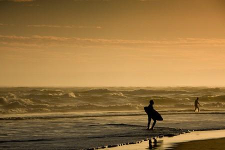 A lone surfer at Les Landes, France