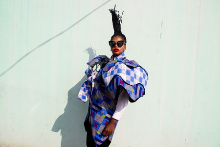 A portrait of designer Tchiana Tchicou-Pembey wearing elements from her Liputta Swagga collection