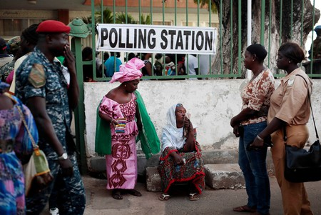 Gambians wait to cast their vote at a polling station in Banjul, The Gambia, December 2016.