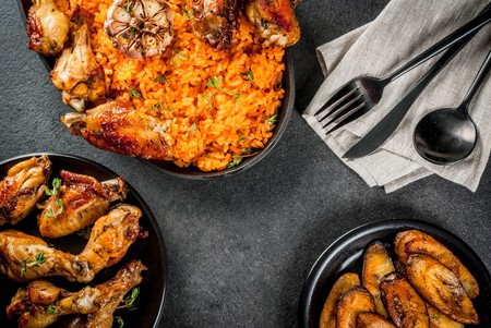 Nigerian jollof rice goes perfectly with grilled chicken wings and fried plantains.