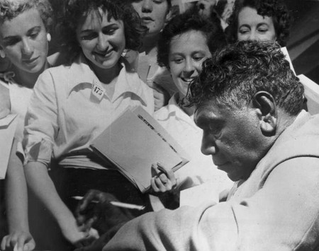 Albert Namatjira signing autographs in the late 1940s