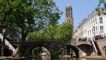 Canal with bridge and Dom Tower in Utrecht, the Netherlands