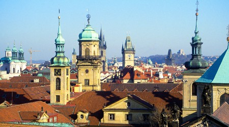 View over rooftops with church towers and domes in Prague, Czech Republic