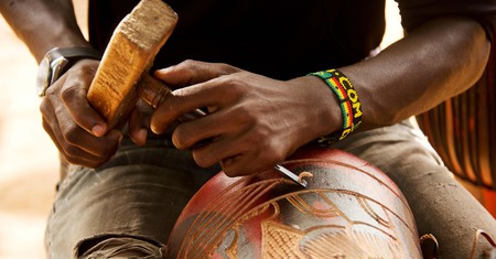 Carving djembe drum
