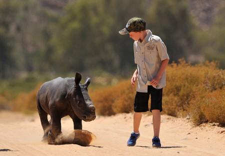Hunter Mitchell with a baby rhino