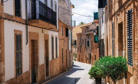 Narrow street of Alcudia, Mallorca, Spain.