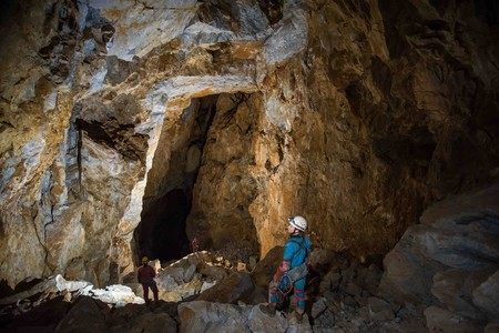 An exploration team enters a tunnel in Cueva de la Peña Negra, northeastern Oaxaca, Mexico