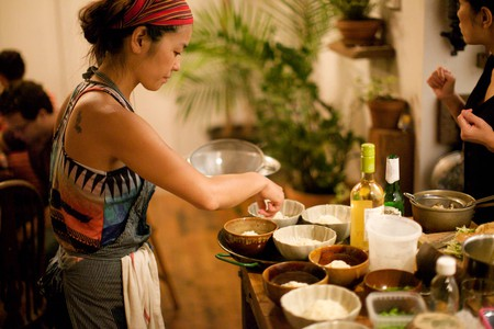 Chef Ai Ito prepares to serve one of the dishes in her multi-course Japanese seafood feast at a recent EatWith dinner in Williamsburg