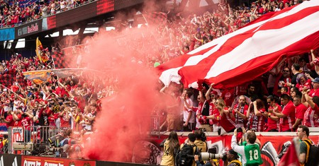 New York Red Bulls soccer fans celebrate during a game at Red Bull Arena