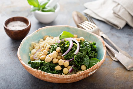 A warm salad with kale, chickpeas and quinoa is a healthy food option
