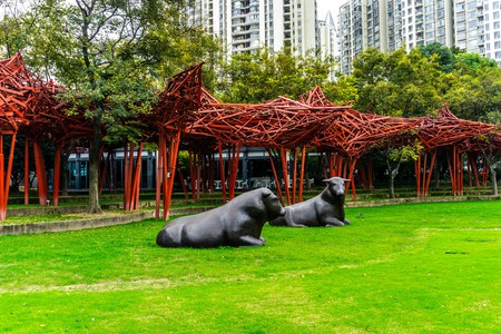 Two Black Bulls Sitting on Grass, Shanghai Jingan Sculpture Park