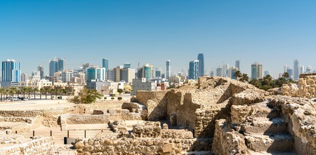 Ruins of Bahrain Fort with skyline of Manama