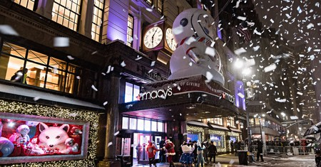 Shoppers pass near the holiday windows at Macy's Herald Square