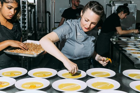 Coreen Carroll, co-founder of the Cannaisseur Series, adds the finishing touches to a CBD bisque