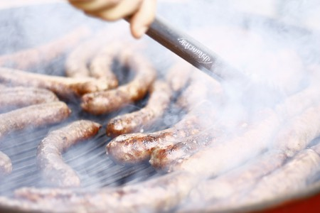 Braaing sausages is Mzoli's speciality