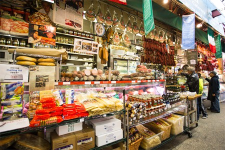 Shoppers place orders at an Italian deli in Little Italy in the Bronx